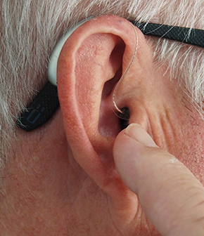 ear with hearing aid in it